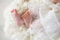 New born baby feet on a white blanket Stock Images