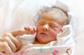 New born baby first touch a sleeping girl holds on to her mom s finger in this gentle Stock Images