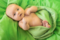 New born baby green background Royalty Free Stock Images