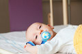 New born child with pacifier sedated before operation. Royalty Free Stock Photo