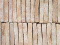 New brick pavers stacked in rows like wall. Store of bricks ready for building or sale. Construction materials and outdoor sto Royalty Free Stock Photo