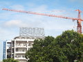 New building under construction with a large crane Stock Photo