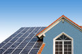 New built house, rooftop with solar cells Royalty Free Stock Photo