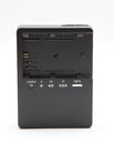 New camera battery charger digital on white Royalty Free Stock Photography