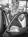 New car blond young woman holding the keys in a dealership Royalty Free Stock Photo