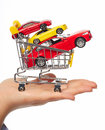 New car in shopping cart auto dealership concept background Stock Photo