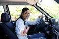 New car: teenage girl showing victory sign Royalty Free Stock Photography