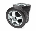 New car wheel with winter tire stacked up and on white background Royalty Free Stock Photography