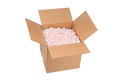 New cardboard box full pink protective packaging peanuts ready shipping Royalty Free Stock Image