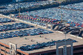 New cars terminal export air photo image overlooking hundreds of manufactured car vehicles parked in harbor yards or buildings for Stock Image