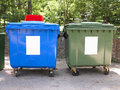 New colorful plastic garbage containers in a park Royalty Free Stock Photos
