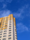 New colorful yellow building, blue sky Royalty Free Stock Photo