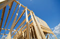 New construction home framing residential against blue sky Royalty Free Stock Image