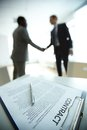 New contract image of business on background of two employees handshaking Royalty Free Stock Photography