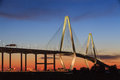 The new cooper river bridge also known as the ravenel bridge connects downtown charleston to mount pleasant south carolina sunset Royalty Free Stock Images