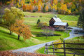 New england countryside farm in autumn landscape fall foliage at woodstock vermont old wooden barn surrounded by colorful trees Royalty Free Stock Image