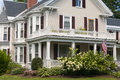 New england house porch an old with a large white bay windows and landscaping Royalty Free Stock Image