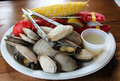 New england lobster bake a traditional which includes clams corn on the cob and Royalty Free Stock Image