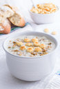 New england style clam chowder creamy in white crock Royalty Free Stock Image