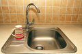 New faucets and sinks in the kitchen Royalty Free Stock Photos