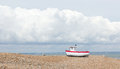 New fishing boat seen ashore on a uk beach Stock Photos