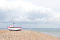 New fishing boat seen ashore on a uk beach Royalty Free Stock Photos