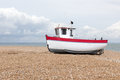 New fishing boat seen ashore on a uk beach Royalty Free Stock Image