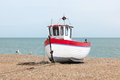 New fishing boat seen ashore on a uk beach Royalty Free Stock Photo