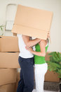 New flat for newly married couple happy young staying together in their common and kissing under the box Royalty Free Stock Photo
