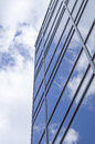New glass building with reflecting clouds Royalty Free Stock Photo