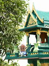 New green spirit house with flowers and joss sticks jar in country thailand Stock Photo