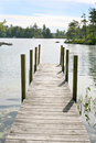 New hampshire dock a reaching out into lake winnipesaukee Stock Images