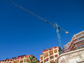 New holiday apartments under construction a block of aprtments dominated by a tall crane malaga spain Stock Images