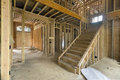 New home construction framing foyer area two storey studs with entryway and staircase Royalty Free Stock Photos