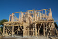 New home construction residential house framing against a blue sky Royalty Free Stock Photos