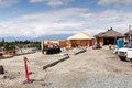 New home construction site with partially built homes Royalty Free Stock Photo