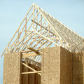 New home under construction showing roof truss framing Stock Images