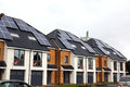 New homes with solar power newly built houses panels on roof Royalty Free Stock Photo