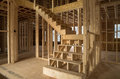 New house construction interior with exposed framing and stairs Royalty Free Stock Photos