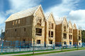 New housing project under construction showing the open roof trusses Royalty Free Stock Photos