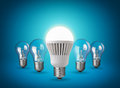 New idea concept with light bulbs on blue background Royalty Free Stock Image