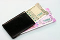 New Indian currency of 2000 and 500 rupee notes into the money purse. Royalty Free Stock Photo