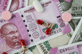 New Indian Rupee Bank Notes with Medicines / Pills Royalty Free Stock Photo