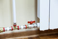 New installed central heating radiator with valve Royalty Free Stock Photo