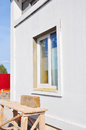 New installed white plastic window with plastered and painted new wall house Stock Photo