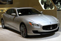 New italian sports sedan at auto show front quarter view of high performance miami view of grille hood side and headlamps maserati Royalty Free Stock Image