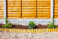 New landscaped wood chip garden border Royalty Free Stock Photo