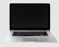 New laptop for sale isolated on grey background Stock Photos