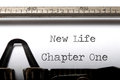 New life chapter printed on a vintage typewriter Royalty Free Stock Photo