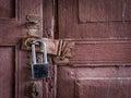 New lock on old wooden door Royalty Free Stock Photo